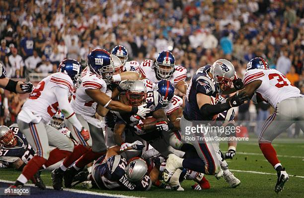 Kevin Faulk of the New England Patriots is tackled by the New York Giants defense at the goal line during Super Bowl XLII on February 3 2008 at...