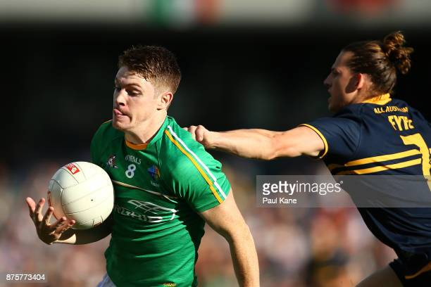 Kevin Feely of Ireland looks to break from a tackled by Nathan Fyfe of Australia during game two of the International Rules Series between Australia...