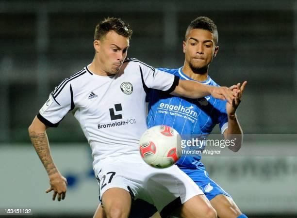 Kevin Feiersinger of Elversberg battles for the ball with Jeremy Toljan of Hoffenheim during the fourth league match between SV Elversberg and TSG...