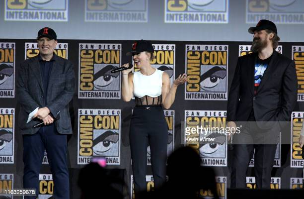 Kevin Feige Scarlett Johansson and David Harbour speak at the Marvel Studios Panel during 2019 ComicCon International at San Diego Convention Center...