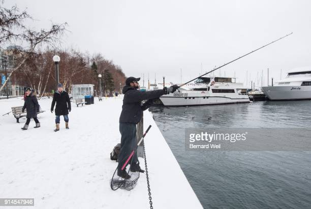 TORONTO ON FEBRUARY 4 Kevin Fernandes casts a large lure in the hopes of catching northern pike on Queens Quay near Dan Leckie Way Fernandes says he...