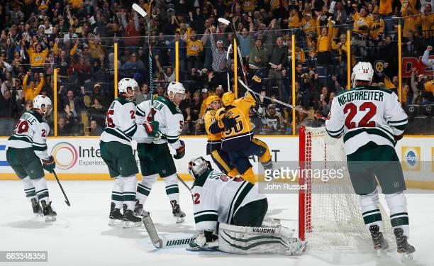 Kevin Fiala celebrates his goal with Calle Jarnkrok of the Nashville Predators against Alex Stalock of the Minnesota Wild during an NHL game at...