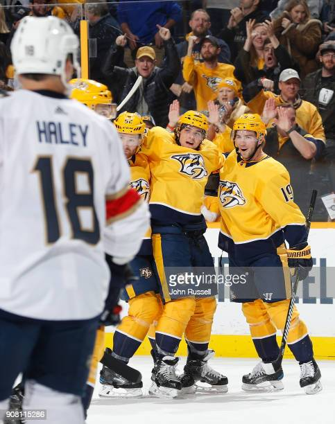 Kevin Fiala celebrates his second goal of the game with Calle Jarnkrok and Matt Irwin of the Nashville Predators against the Florida Panthers during...