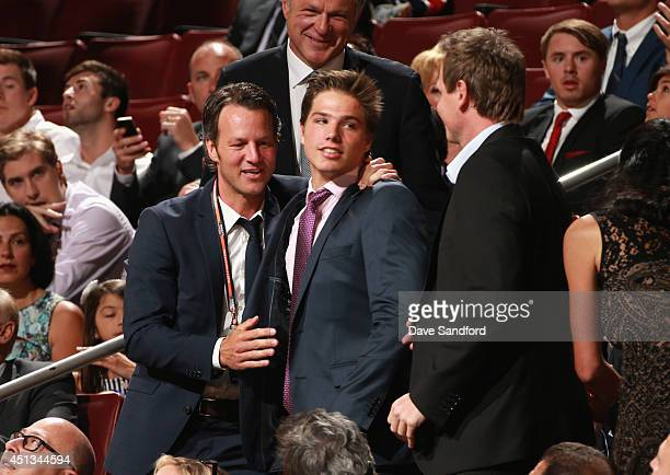 Kevin Fiala celebrates with his family after being selected 11th overall by the Nashville Predators during the 2014 NHL Entry Draft at Wells Fargo...