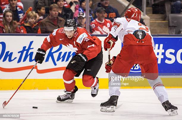 Kevin Fiala of Switzerland moves the puck against Anders Krogsgaard during the 2015 IIHF World Junior Championship on December 30 2014 at the Air...