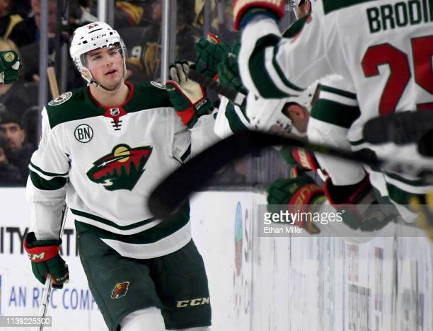 Kevin Fiala of the Minnesota Wild celebrates with teammates on the bench after scoring a secondperiod powerplay goal against the Vegas Golden Knights...