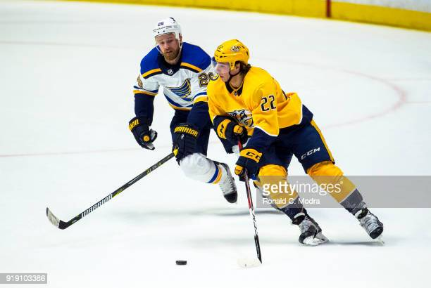 Kevin Fiala of the Nashville Panthers skates against Kyle Brodziak of the St Louis Blues during an NHL game at Bridgestone Arena on January 16 2018...