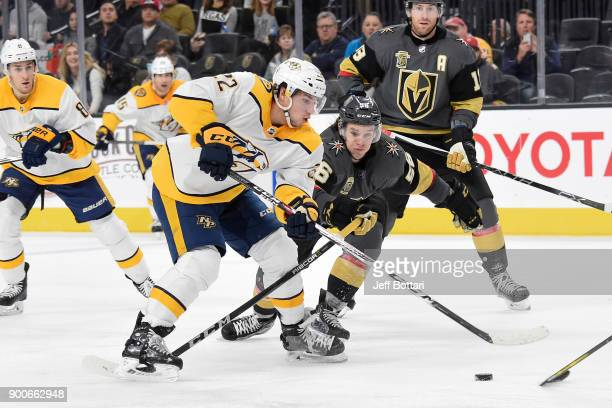 Kevin Fiala of the Nashville Predators and Erik Haula of the Vegas Golden Knights skate to the puck during the game at TMobile Arena on January 2...