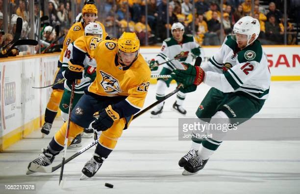 Kevin Fiala of the Nashville Predators battles for the puck against Eric Staal of the Minnesota Wild during an NHL game at Bridgestone Arena on...
