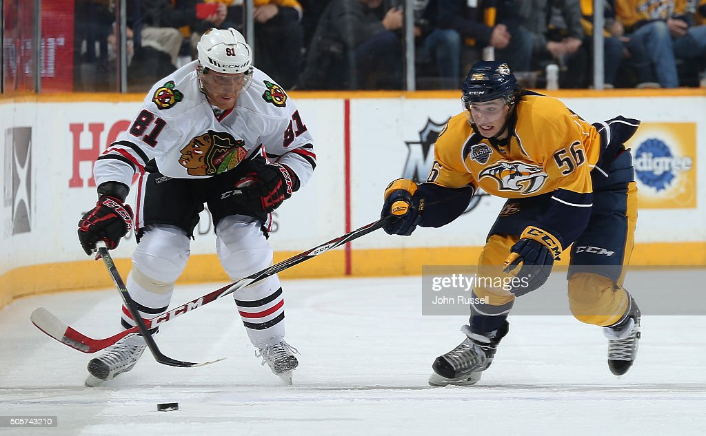 Kevin Fiala #56 of the Nashville Predators battles for the puck against Marian Hossa #81 of the Chicago Blackhawks during an NHL game at Bridgestone Arena on January 19, 2016 in Nashville, Tennessee.