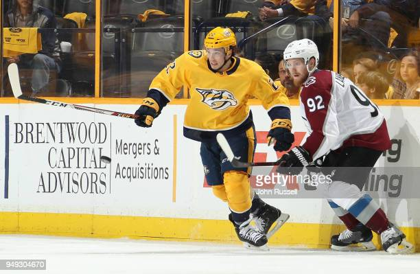 Kevin Fiala of the Nashville Predators battles for the puck against Gabriel Landeskog of the Colorado Avalanche in Game Five of the Western...