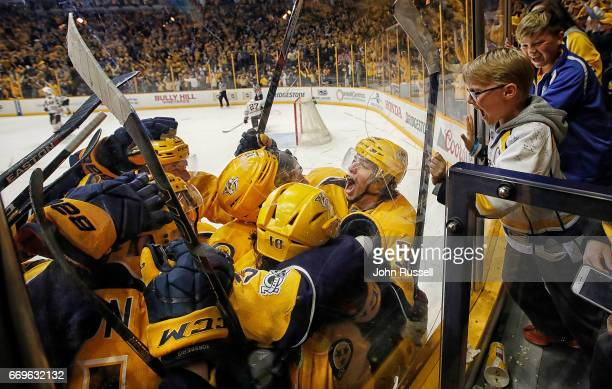 Kevin Fiala of the Nashville Predators celebrates his game winning overtime goal against the Chicago Blackhawks in Game Three of the Western...