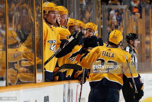 Kevin Fiala of the Nashville Predators celebrates his second goal of the game with the bench against the Florida Panthers during an NHL game at...
