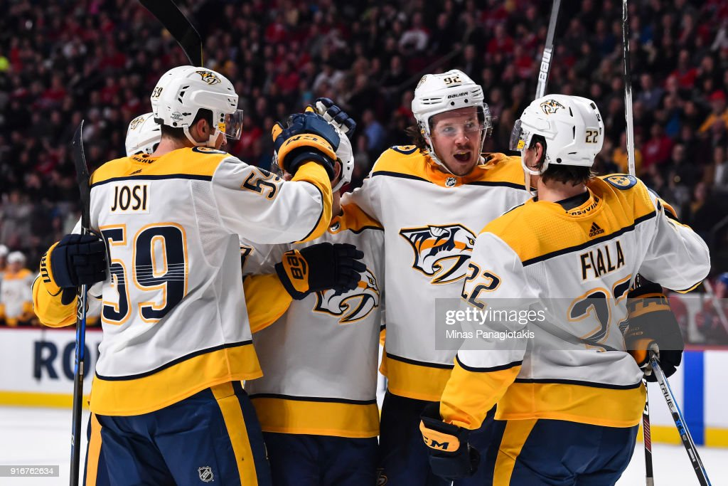 Kevin Fiala #22 of the Nashville Predators celebrates his third period goal with teammates Roman Josi #59 and Ryan Johansen #92 against the Montreal Canadiens during the NHL game at the Bell Centre on February 10, 2018 in Montreal, Quebec, Canada. The Nashville Predators defeated the Montreal Canadiens 3-2 in a shootout.