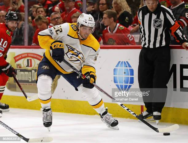 Kevin Fiala of the Nashville Predators controls the puck against the Chicago Blackhawks at the United Center on October 14 2017 in Chicago Illinois...