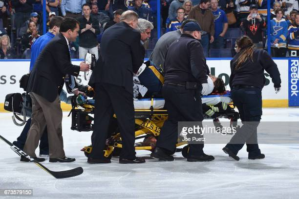 Kevin Fiala of the Nashville Predators is taken off the ice on a stretcher after getting injured during a game against the St Louis Blues in Game One...