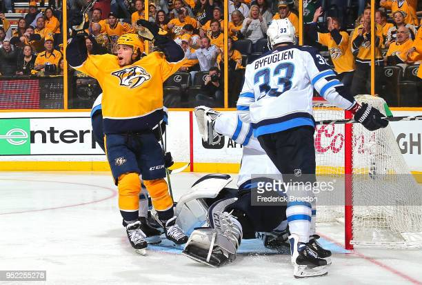 Kevin Fiala of the Nashville Predators reacts after scoring a goal against Dustin Byfuglien of the Winnipeg Jets during the third period of a 41 Jets...