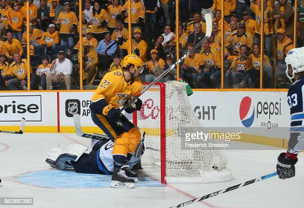 Kevin Fiala of the Nashville Predators scores the game winning goal against goalie Connor Hellebuyck in the second period of overtime in a 54...