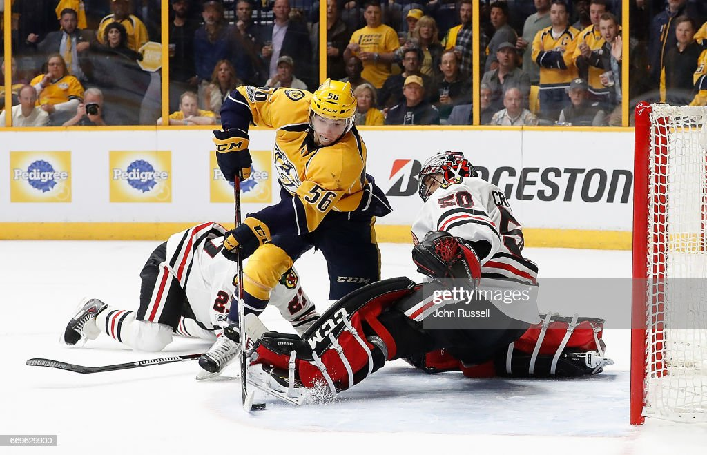 Kevin Fiala #56 of the Nashville Predators scores the overtime game winning goal against Corey Crawford #50 of the Chicago Blackhawks in Game Three of the Western Conference First Round during the 2017 NHL Stanley Cup Playoffs at Bridgestone Arena on April 17, 2017 in Nashville, Tennessee.