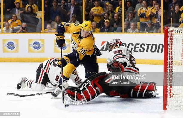 Kevin Fiala of the Nashville Predators scores the overtime game winning goal against Corey Crawford of the Chicago Blackhawks in Game Three of the...