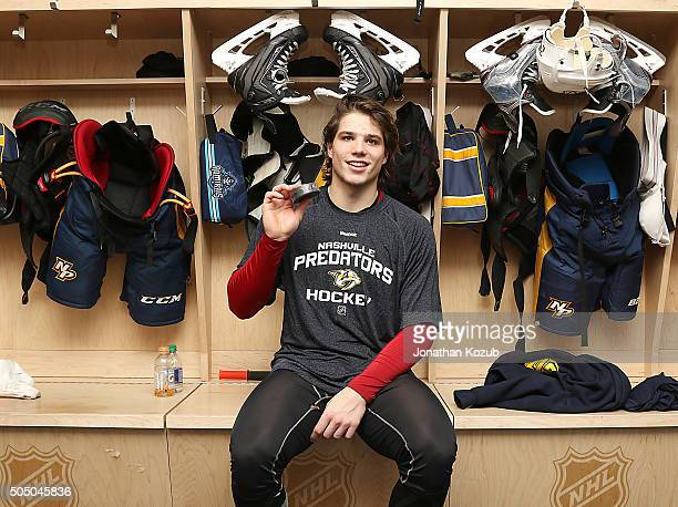 Kevin Fiala of the Nashville Predators shows off the puck after scoring his first career goal during first period action against the Winnipeg Jets at...