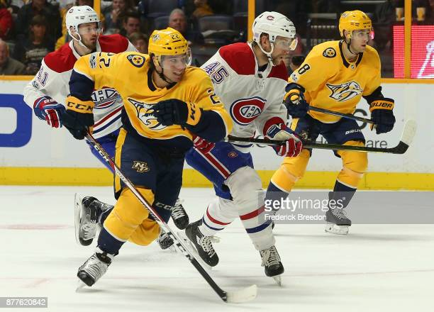 Kevin Fiala of the Nashville Predators skates against Joe Morrow of the Montreal Canadiens during the first period at Bridgestone Arena on November...