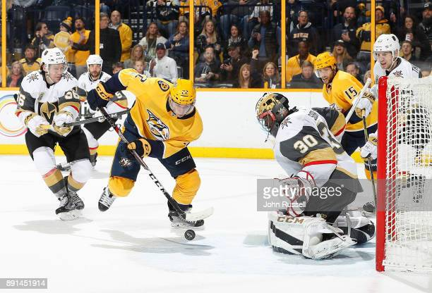 Kevin Fiala of the Nashville Predators skates in with the puck against Malcolm Subban of the Vegas Golden Knights during an NHL game at Bridgestone...