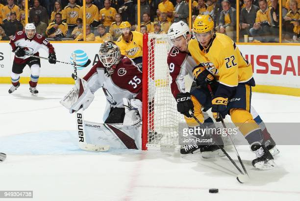 Kevin Fiala of the Nashville Predators skates the puck around the net against Samuel Girard and Andrew Hammond of the Colorado Avalanche in Game Five...