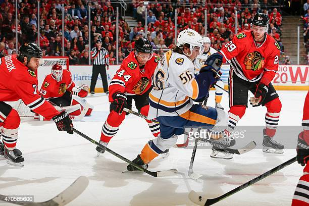 Kevin Fiala of the Nashville Predators skates through the sticks of Brent Seabrook Kimmo Timonen and Bryan Bickell of the Chicago Blackhawks during...
