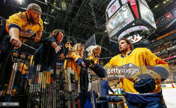 Kevin Fiala of the Nashville Predators taps hands with fans after warmups prior to Game Seven of the Western Conference Second Round against the...