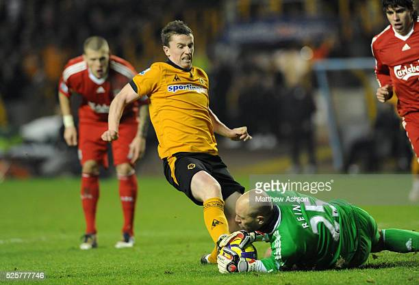 Kevin Foley of Wolverhampton Wanderers challenges Pepe Reina of Liverpool