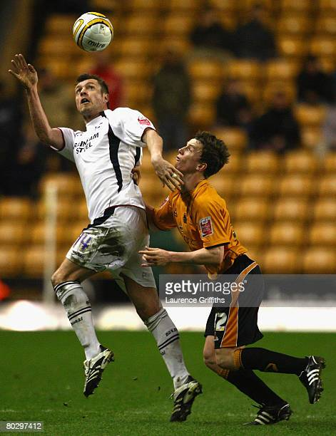 Kevin Foley of Wolves battles with Geoff Horsfield of Scunthorpe during the Coca Cola Championship match between Wolverhampton Wanderers and...