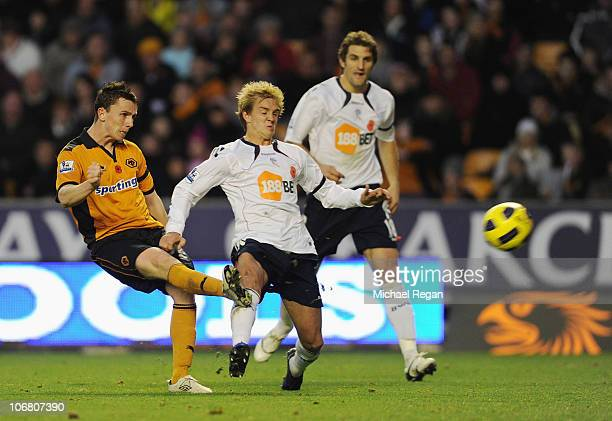 Kevin Foley of Wolves shoots to score the 13 goal the first for his team during the Barclays Premier League match between Wolverhampton Wanderers and...