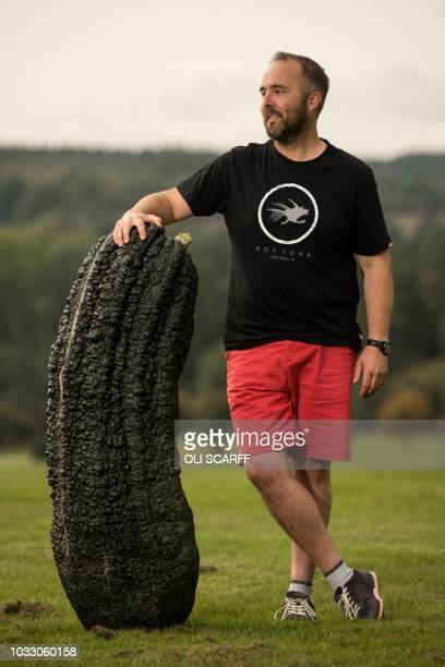 Kevin Fortey poses for a photograph with his 722 kg marrow which won the the heaviest marrow competition on the first day of the Harrogate Autumn...