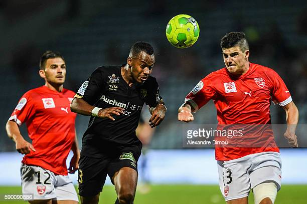 Kevin Fortune of Lens and Anthony Briancon of Nimes during the Ligue 2 game between Lens and Nimes on August 15 2016 in Nimes France