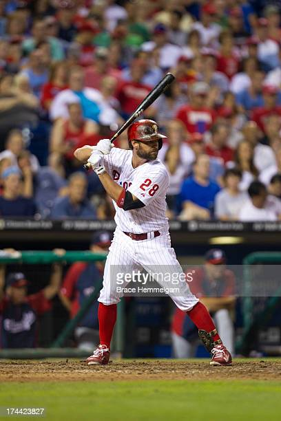Kevin Frandsen of the Philadelphia Phillies bats against the Washington Nationals on July 11 2013 at Citizens Bank Park in Philadelphia Pennsylvania...