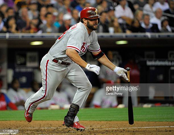 Kevin Frandsen of the Philadelphia Phillies hits an RBI single during the seventh inning of a baseball game against the San Diego Padres at Petco...