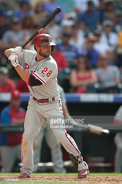 Kevin Frandsen of the Philadelphia Phillies takes an at bat against the Colorado Rockies at Coors Field on June 15 2013 in Denver Colorado The...