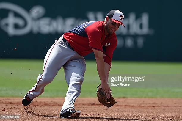 Kevin Frandsen of the Washington Nationals fields a ground ball during a spring training game against the Atlanta Braves at Champion Stadium on March...