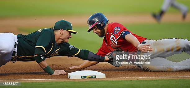 Kevin Frandsen of the Washington Nationals is tagged out at third base by Josh Donaldson of the Oakland Athletics in the top of the fifth inning at...