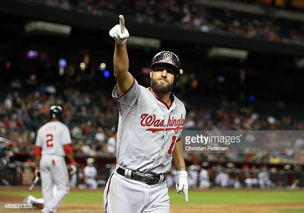 Kevin Frandsen of the Washington Nationals points to the fans after hitting a solo home run against the Arizona Diamondbacks during the ninth inning...