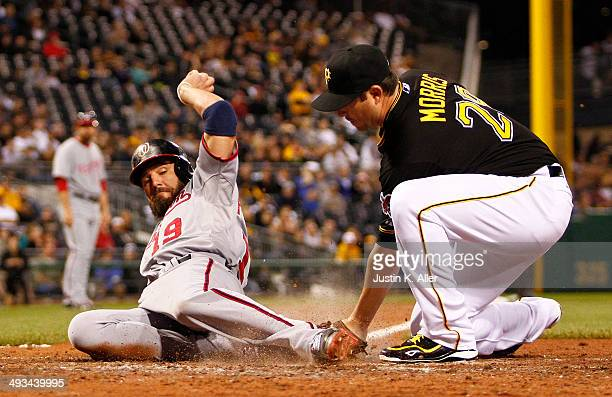 Kevin Frandsen of the Washington Nationals scores on a passed ball in the eighth inning against Bryan Morris of the Pittsburgh Pirates during the...