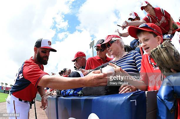 Kevin Frandsen of the Washington Nationals signs autographs for fans prior to a spring training game against the Houston Astros at Space Coast...