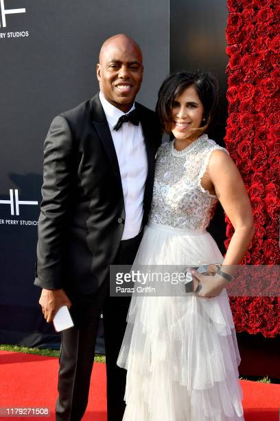 Kevin Frazier and Yazmin Cader Frazier attend Tyler Perry Studios grand opening gala at Tyler Perry Studios on October 05 2019 in Atlanta Georgia