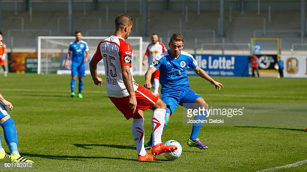 Kevin Freiberger of Lotte challenges Marco Gruettner of Regensburg during the third league match between Sportfreunde Lotte and Jahn Regensburg at...