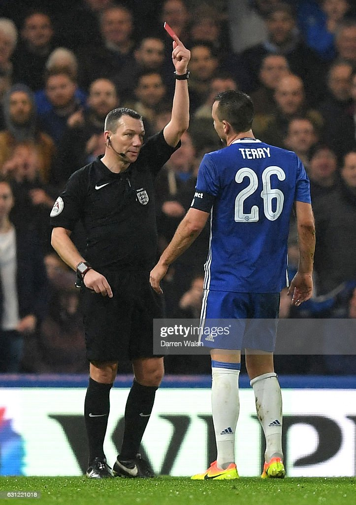 Kevin Friend (L) shows John Terry of Chelsea (R) a red card during The Emirates FA Cup Third Round match between Chelsea and Peterborough United at Stamford Bridge on January 8, 2017 in London, England.
