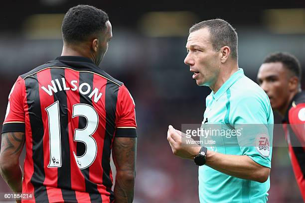 Kevin Friend speaks with Callum Wilson of AFC Bournemouth during the Premier League match between AFC Bournemouth and West Bromwich Albion at...