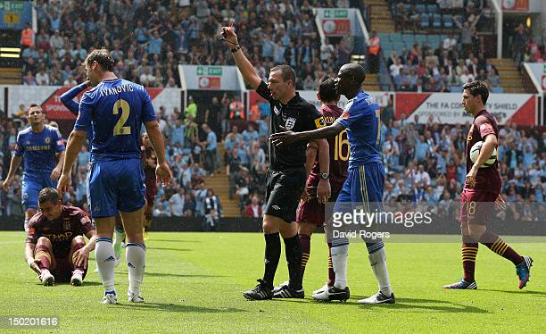 Kevin Friend the referee sends off Branislav Ivanovic of Chelsea after a tackle on Aleksander Kolarov during the FA Community Shield match between...