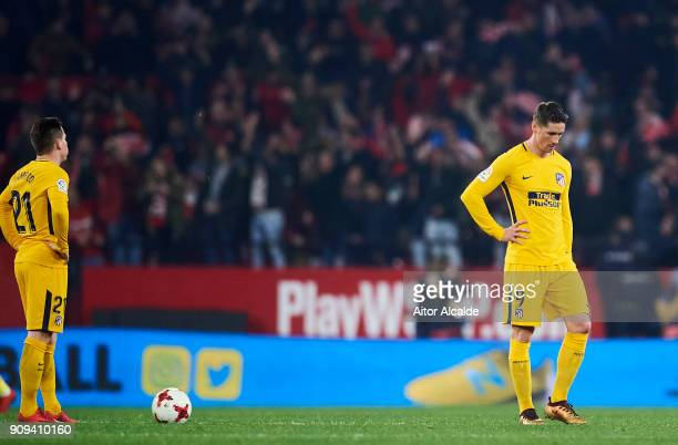 Kevin Gameiro and Fernando Torres of Atletico Madrid reacts during the Copa del Rey Quarter Final second Leg match between Sevilla FC and Atletico de...