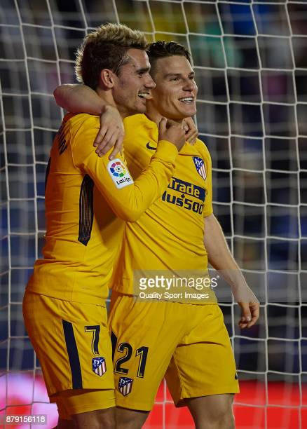 Kevin Gameiro celebrates with Antoine Griezmann of Atletico Madrid after scoring the second goal during the La Liga match between Levante and...